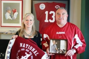 Two people standing in front of red jersey.