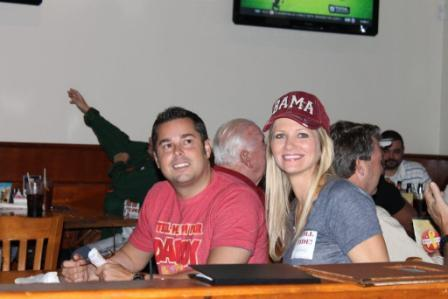 Man in Red shirt and lady in Gray shirt with red BAMA cap.