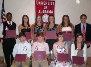 Group of students holding award certificates.