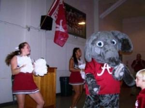 Two Alabama cheerleaders with Big AL.