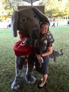 Girl hugging Big Al outside.