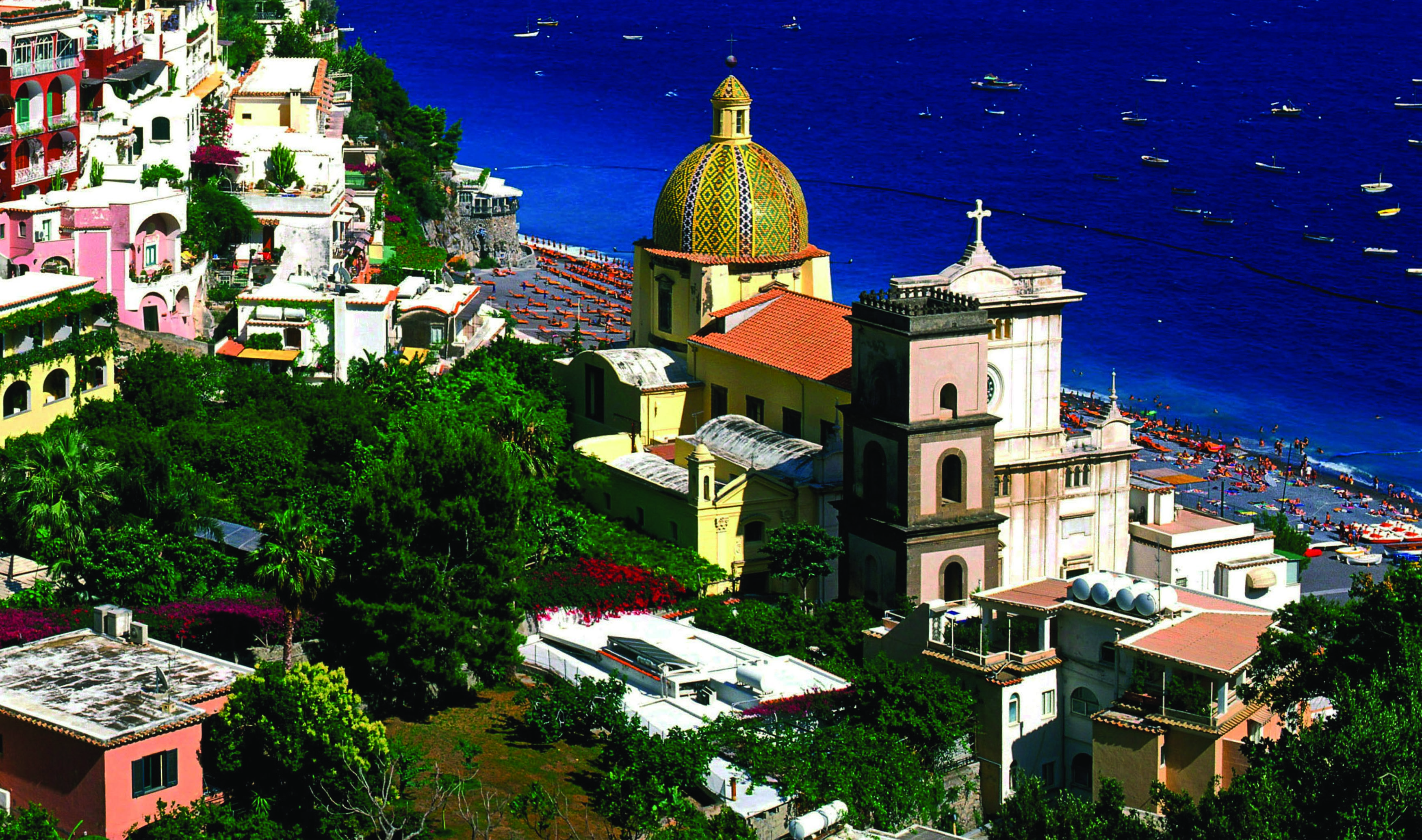 An areal shot of the village of Positano during a sunny day.