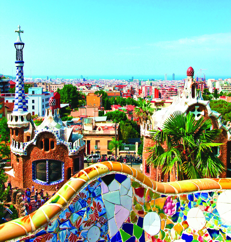 A brightly colorful city that has lots of mosaic elements on the buildings