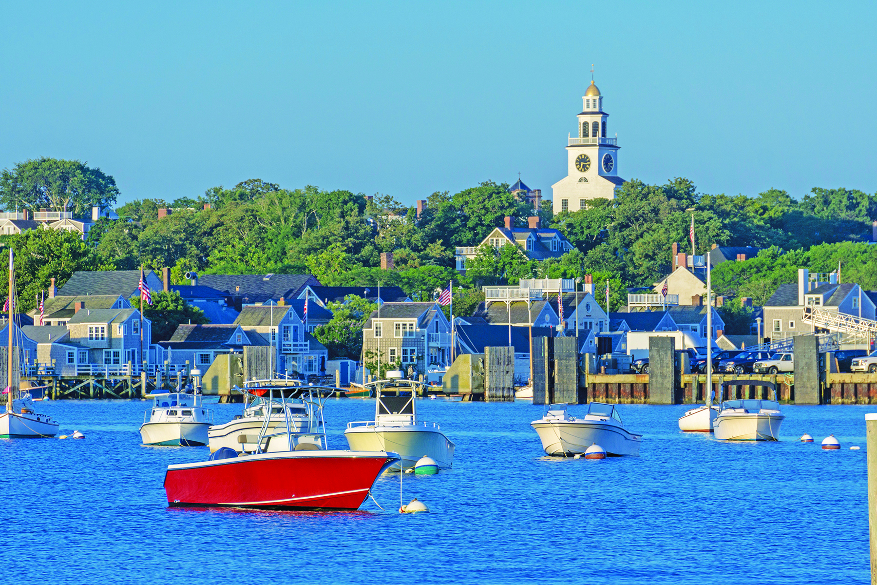 A view of Nantucket Island from the water on a cloudless day