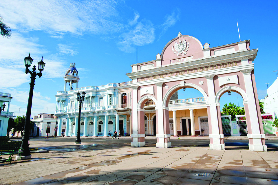 A public square in Cuba with pastel buildings