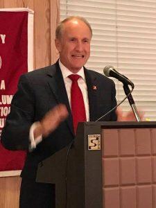 Dr. Stewart Bell standing behind podium