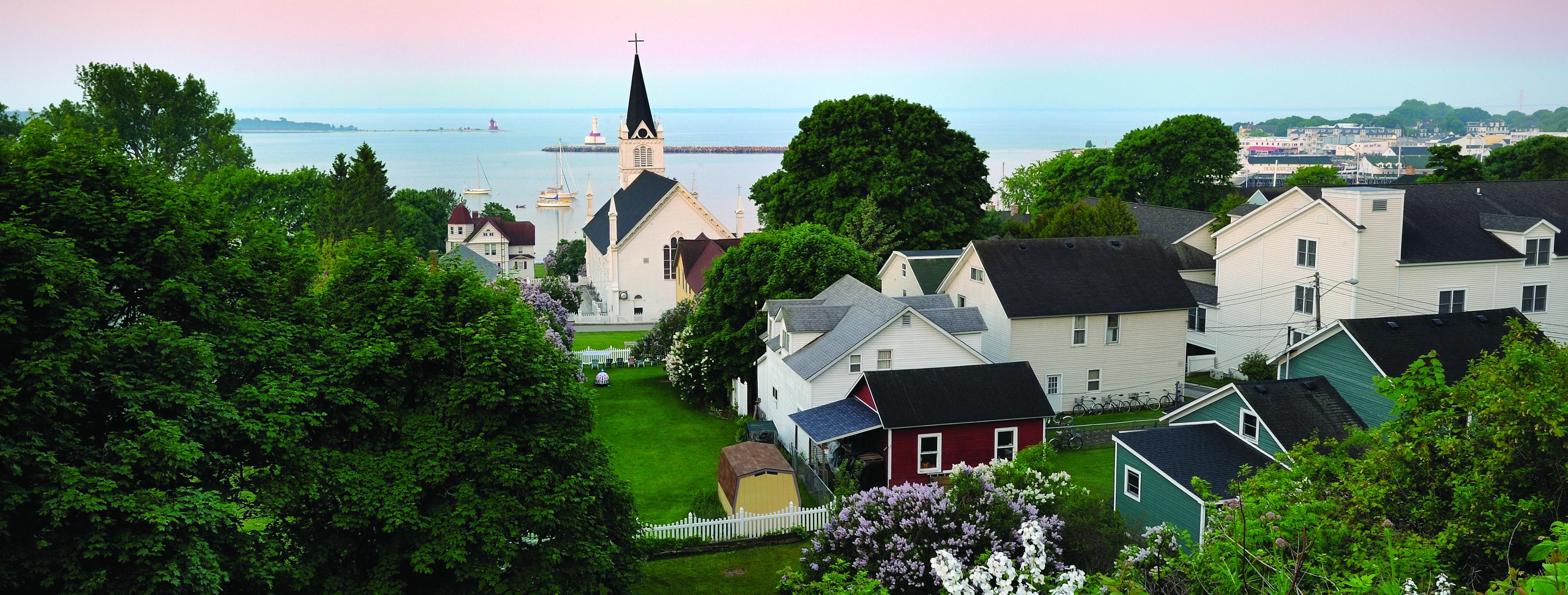 Ariel view of Mackinac island, quaint homes and churches.